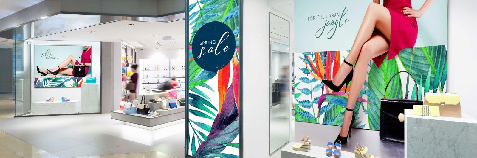 Druckmedien für Messebau, Point of Sale - Schaufenster mit Werbeplakat und Leuchtkastenwerbung