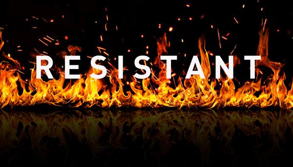 B1 Brandschutz Zertifikat für monomere Vinylfolien. Lodernde Flammen mit dem Begriff resistant.